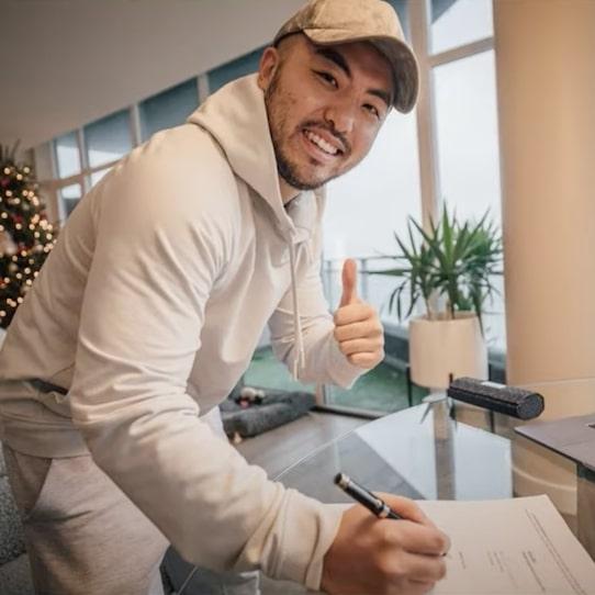 Tom Wang Signs Big Deal
